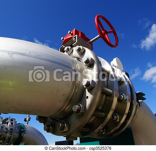 Pipes, tubes, cables and equipment at a power plant - csp3525376