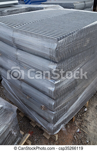 stack of new concrete roof tile (gray color) at construction site
