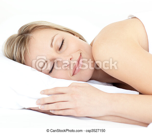 Radiant woman sleeping on her bed  - csp3527150