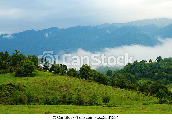 landscape view with mountains and fog - csp3531331