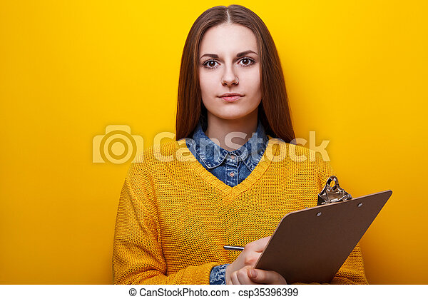 Portrait of attractive girl with clipboard - csp35396399