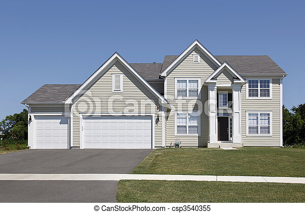 Home with tan siding and arched entry - csp3540355