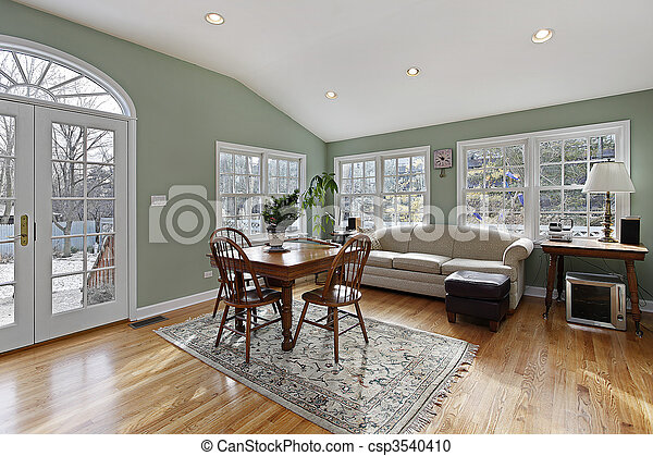 Family room with doors to deck - csp3540410