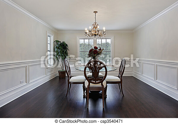 Dining room with dark wood flooring - csp3540471
