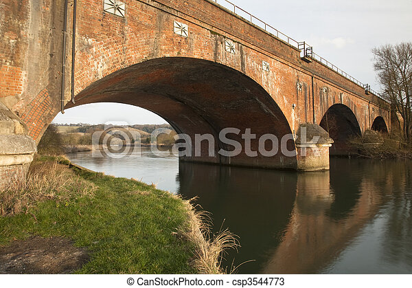 Viaduct over the River Thames near Goring, Oxfordshire, Uk with Hartslock Wood in the background - csp3544773