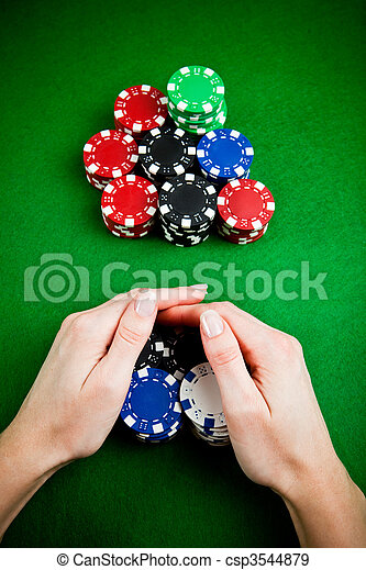 Female hands rakes up stack of gambling chips - csp3544879
