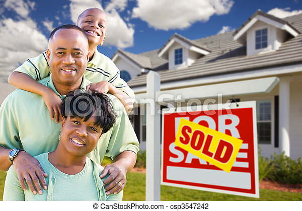 African American Family with Sold For Sale Sign and House - csp3547242