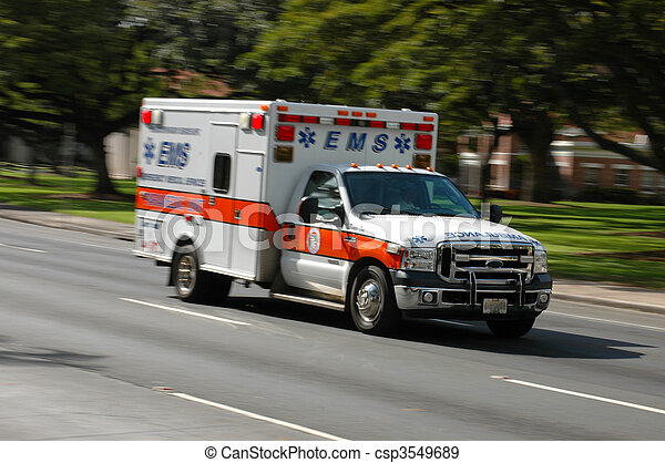 A speeding emergency medical services ambulance, with motion blur - csp3549689
