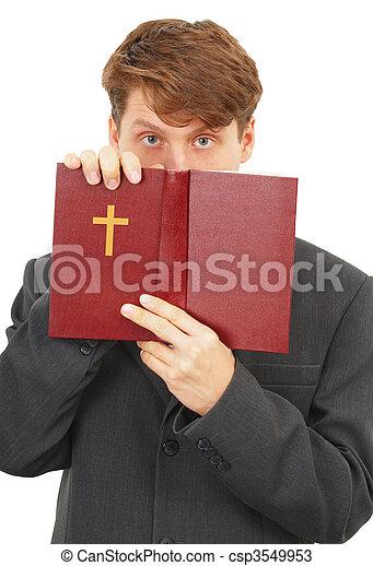 Priest defends the Scriptures - csp3549953