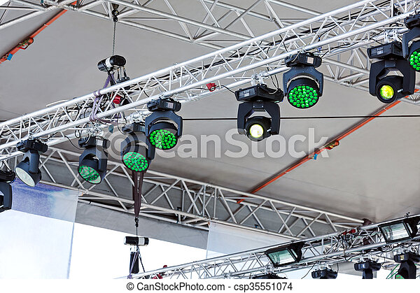 rows spotlights under roof of outdoor concert stage