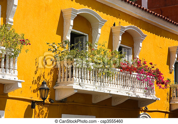 Detail of a colonial house. balcony with flowers and plants - csp3555460