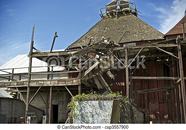A once thriving Hops processing operation is now idle and abandoned in the Farmlands of California. - csp3557900