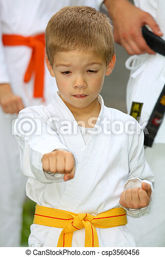 boy in karate suit training - csp3560456