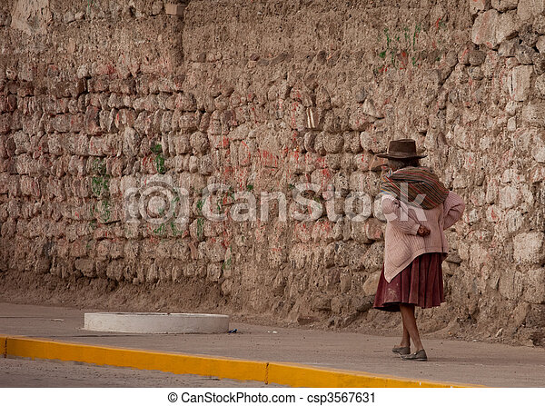 Old Woman walking on street in Peru - csp3567631