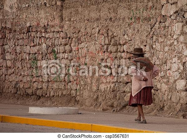 Old Woman walking on street in Peru - csp3567631