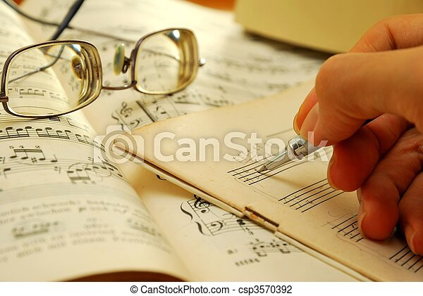 Writing on an old musical manuscript - csp3570392