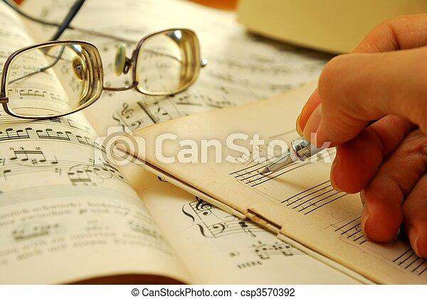Writing on an old musical manuscript - csp3570392