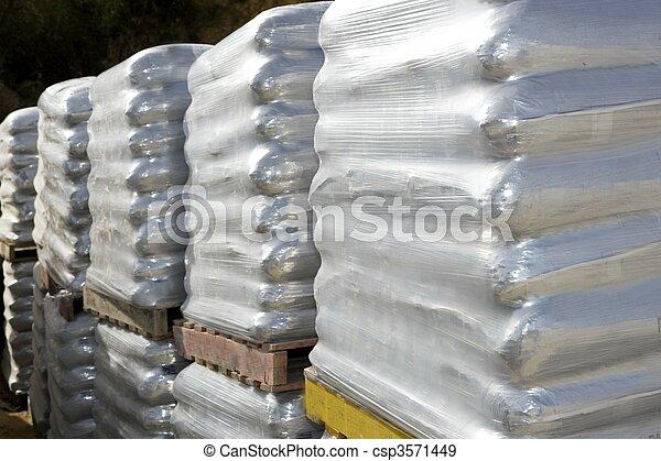 sandbags bags white pallet sacks stacked - csp3571449