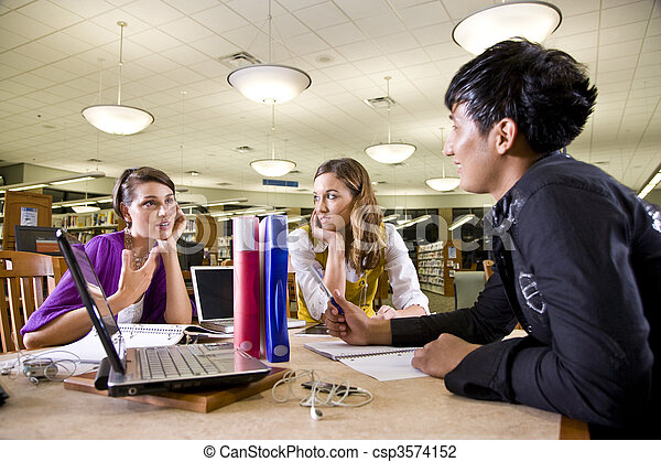 Three university students studying together - csp3574152