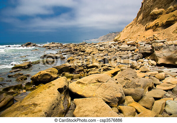 Rocky shoreline along the ocean - csp3576886