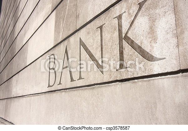 bank writing carved onto a stone wall - csp3578587