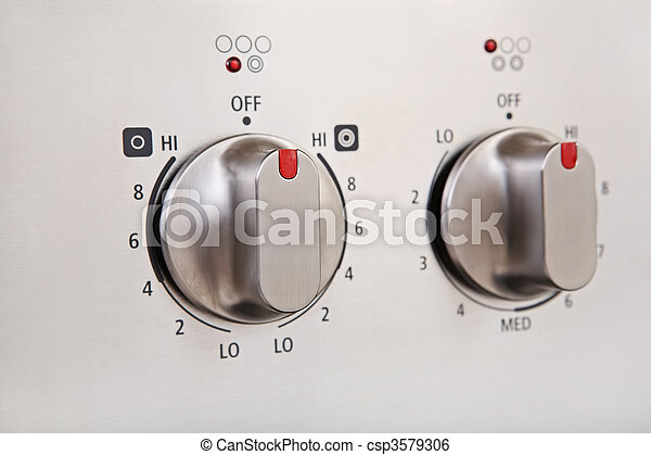 Knobs on a modern stainless steel stove - csp3579306