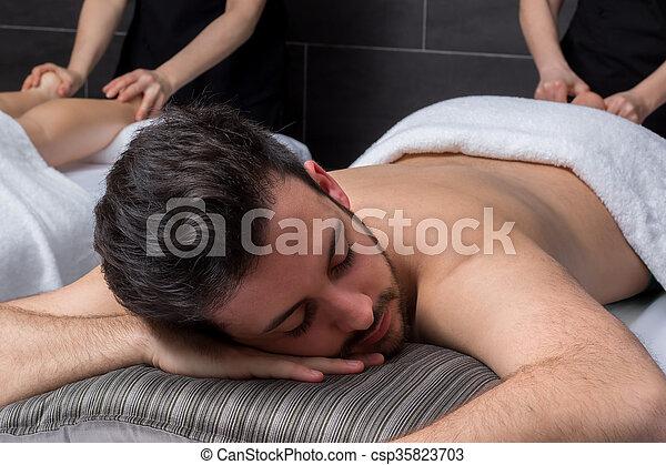 Young man enjoying massage with girlfriend.