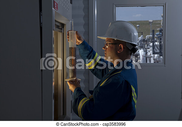 Petroleum Worker Measuring Chemicals - csp3583996