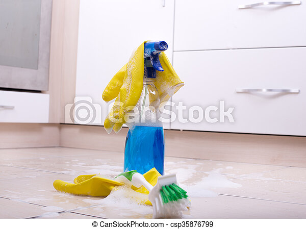 Cleaning supplies on the kitchen floor with foam around them