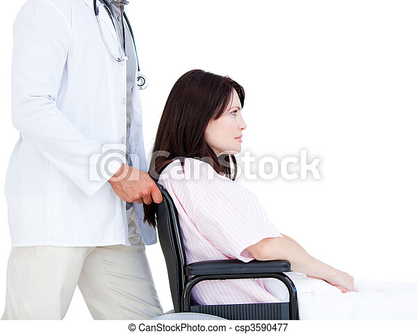 Upset female patient in a wheelchair with her doctor - csp3590477