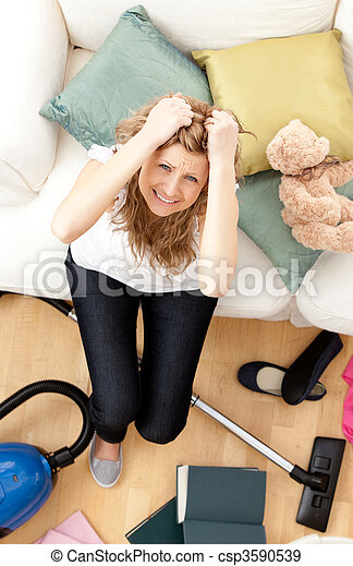 Frustrated young woman doing housework - csp3590539