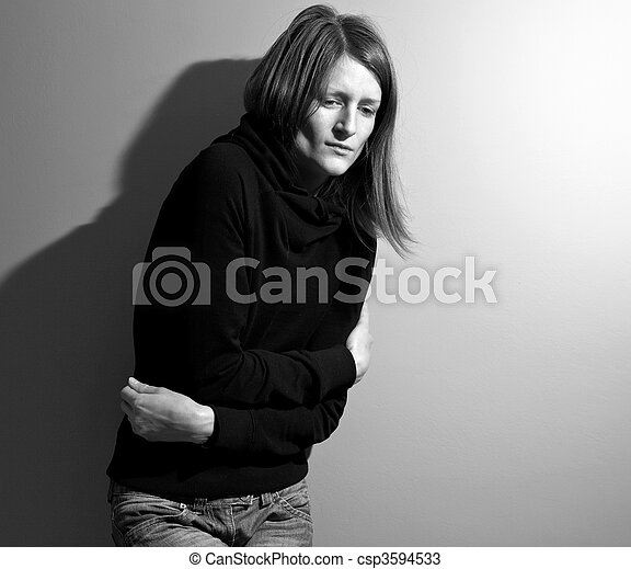 Young woman suffering from a severe stomach pain/depression/anxiety - csp3594533