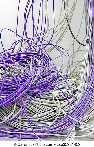 A bundle of communication cables are hanging from the ceiling in room.