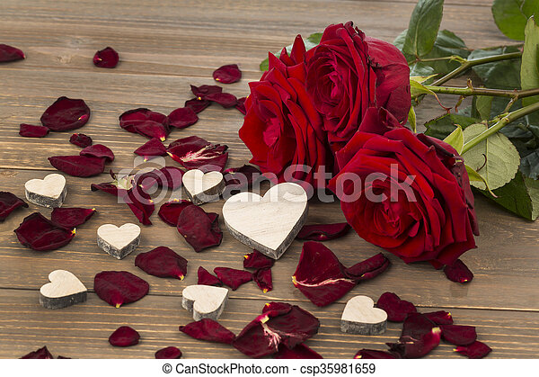 roses as a gift and surprise to a party. symbol photo for birthday, mother\'s day, love, valentine