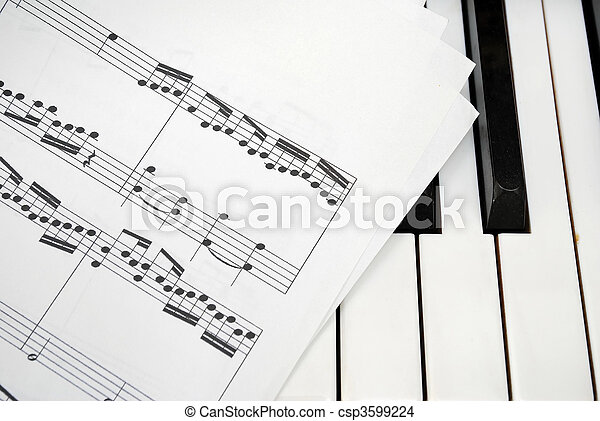 Multiple music score sheets on piano keyboard - csp3599224