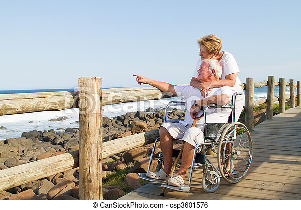 tender senior couple on beach - csp3601576