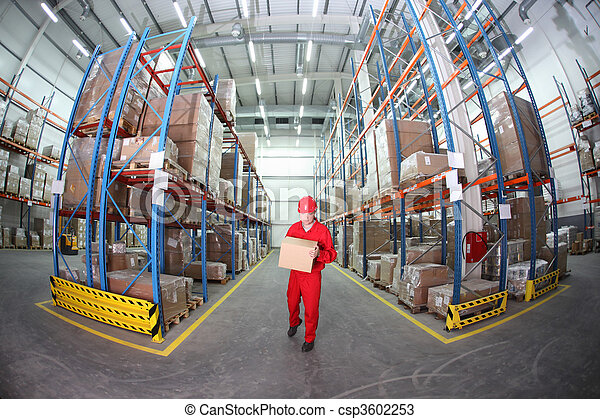 worker in uniform carrying box - csp3602253