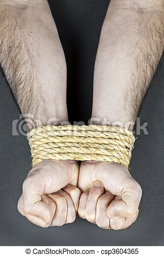 Wrists tied with rope - csp3604365
