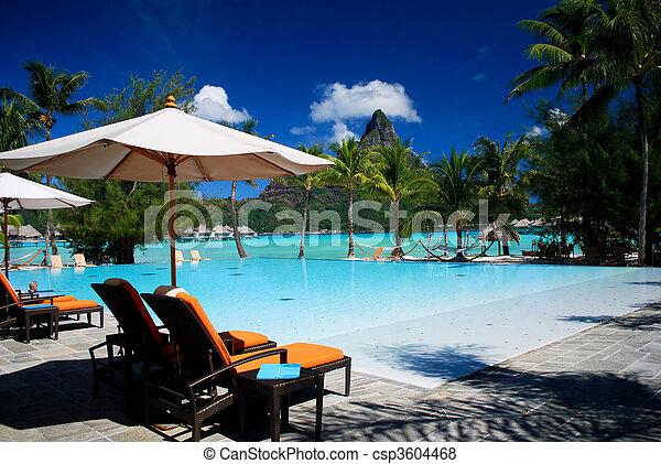 swimming pool at a tropical resort - csp3604468