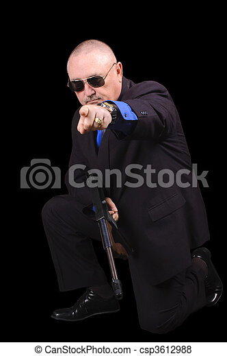 Gangster or Government agent, FBI agent, over a black background - csp3612988