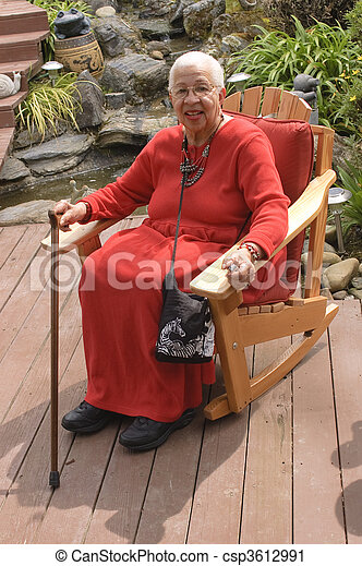 Elderly African American Woman sitting in garden - csp3612991