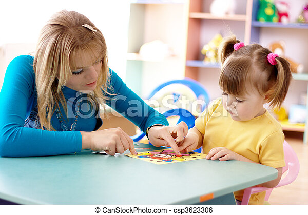 Teacher and child in preschool - csp3623306