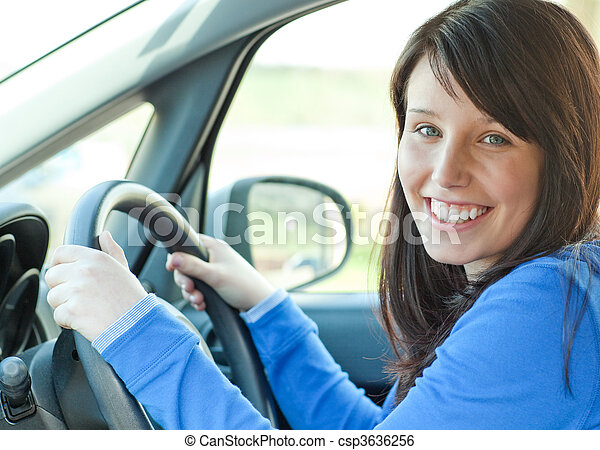 Pretty woman driving her car - csp3636256