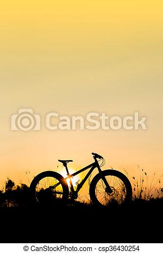 silhouette fat bike at sunset, fat tire bike at sunset