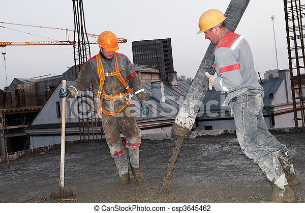 builder worker pouring concrete into form - csp3645462
