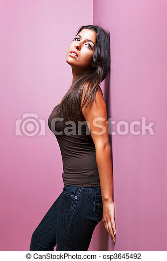 Woman leaning against a wall - csp3645492