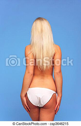 Rear view blond woman wearing bikini - csp3646215
