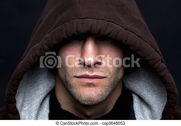 Evil looking hooded man - csp3648053