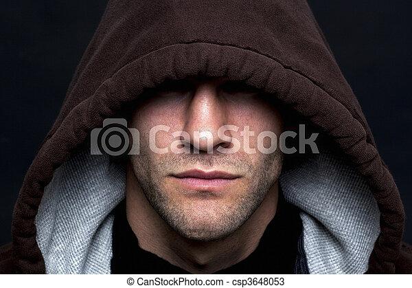 Evil looking hooded man - csp3648053