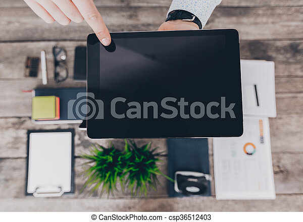 Young businessman working with modern devices - csp36512403